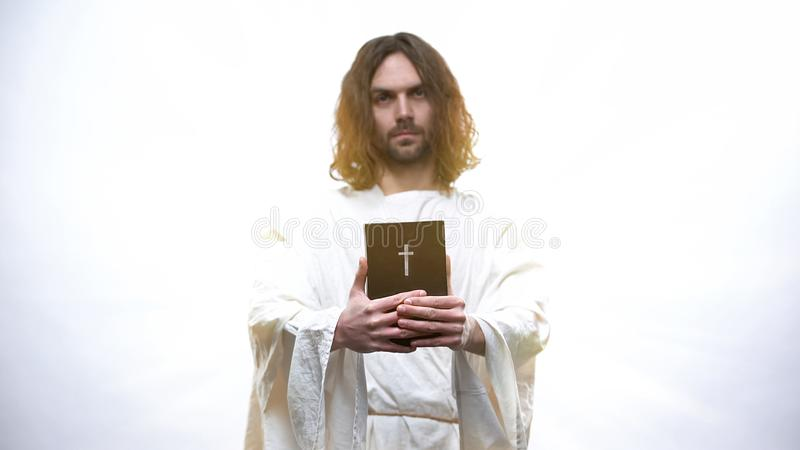Saint Prophet holding Bible, revelation teachings for Christians, Commandments. Stock photo royalty free stock photo