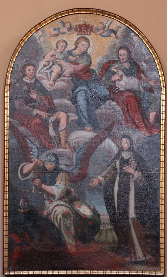 Saint Roch, Agnes, Michael and Clare of Assisi. Painting on church altar royalty free stock photos