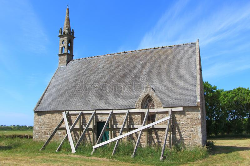 Saint Roch chapel in Plourin. With reinforcing plank against the wall royalty free stock image