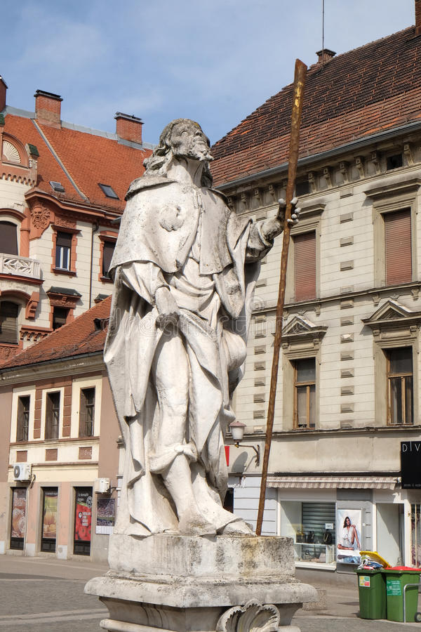 Saint Roch. Statue, Plague column at Main Square of the city of Maribor in Slovenia, Europe. Historical religious sculpture stock photography