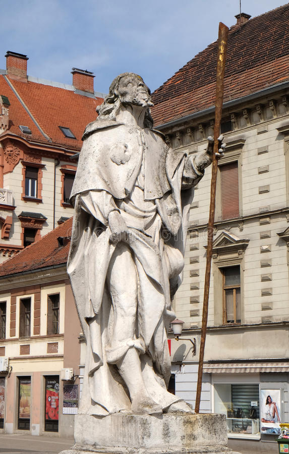 Saint Roch. Statue, Plague column at Main Square of the city of Maribor in Slovenia, Europe. Historical religious sculpture royalty free stock images