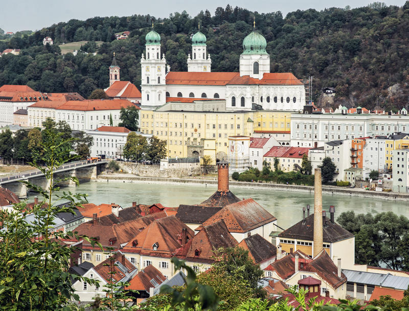 Saint Stephen's cathedral, Passau city, Germany. City panorama. Largest church pipe organ. Urban scene. Red roofs. Cultural heritage stock images