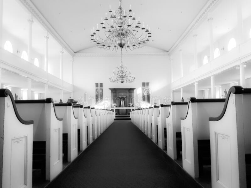 Saint Stephen`s Catholic Church, North End, Boston, Massachusetts. Monochrome architectural image of  pews, altar, and ceiling with walk in North End, Boston stock images