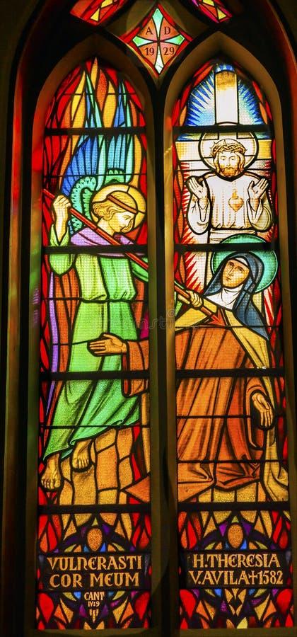 Saint Teresa Avila Stained Glass De Krijtberg Amsterdam Netherlands. Saint Teresa Avila Angel Spear Christ Stained Glass De Krijtberg Church Amsterdam Holland stock images