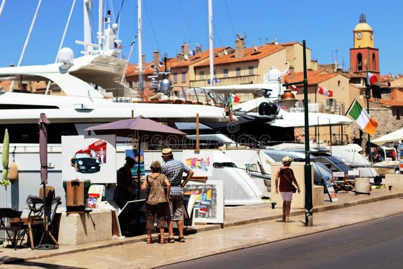 Saint Tropez harbor Street scene in summer stock photos