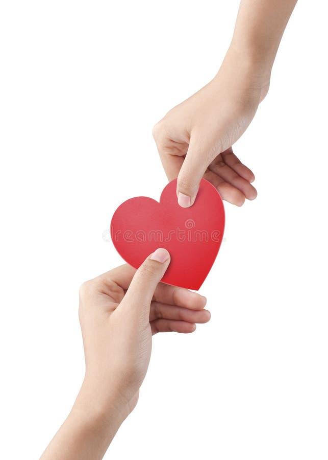 Saint Valentin rouge de coeur sur le blanc avec le chemin de coupure photos stock
