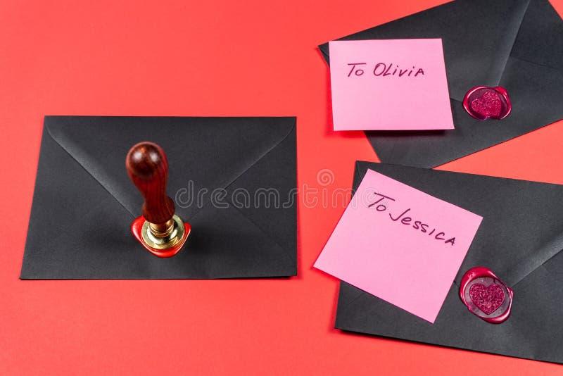 Saint Valentine`s Day concept.Heart Wax Stamp stock photos