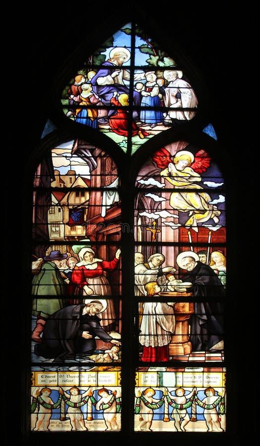 Saint Vincent de Paul que levanta um recém-nascido e batizar imagem de stock royalty free