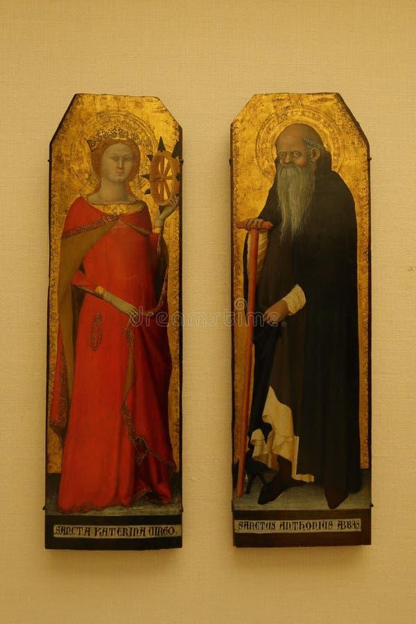 Sainte catherine d'Alexandrie Saint Antoine abbe tavla på Louvre-museet i Paris royaltyfri bild