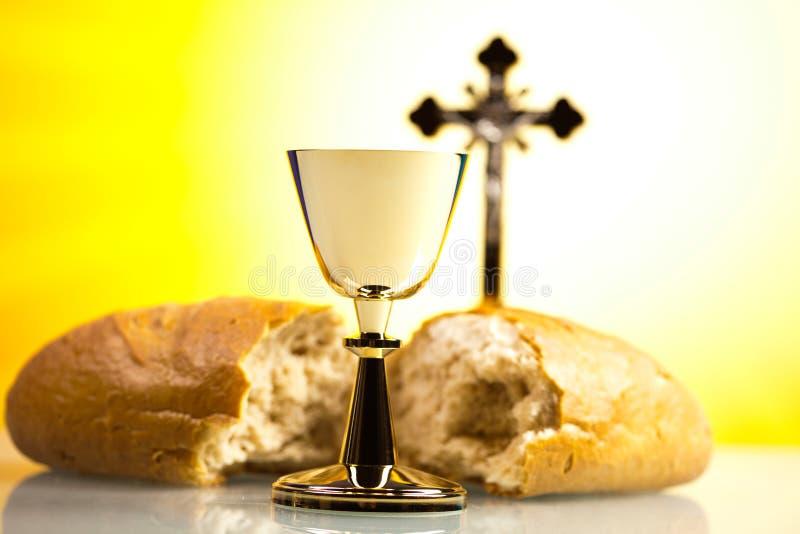 Sainte communion chrétienne, fond lumineux, concept saturé image stock