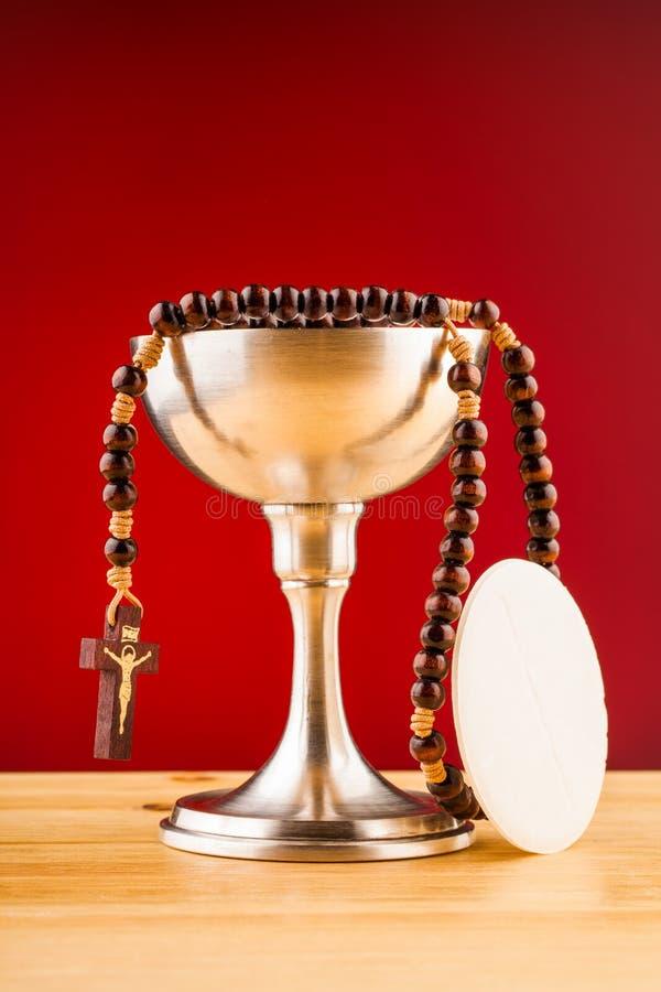 Sainte communion et argent photos stock