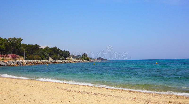 Sainte Maxime beach, France. One of the beautiful beaches of Sainte Maxime, located on the French Riviera (Côte d'Azur) near Saint Tropez, in southeastern royalty free stock image