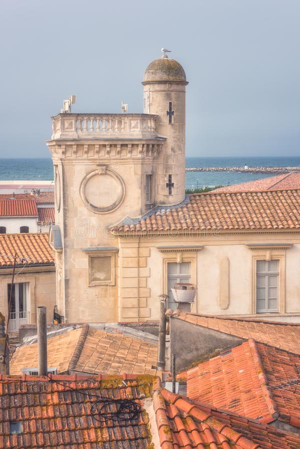 Saintes-Maries-de-la-Mer, top view of town tiled roofs, building of ancient Town Hall and seaside, Camargue, France royalty free stock image