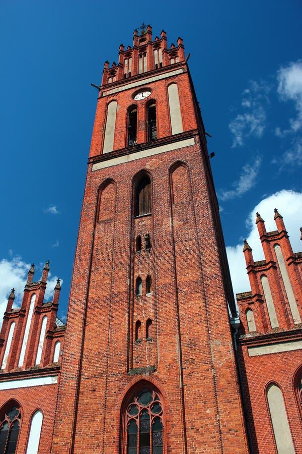 Saints Peter i Paul kościół w Pieniezno, Warmian-Masurian Voivodeship, Polska obraz royalty free