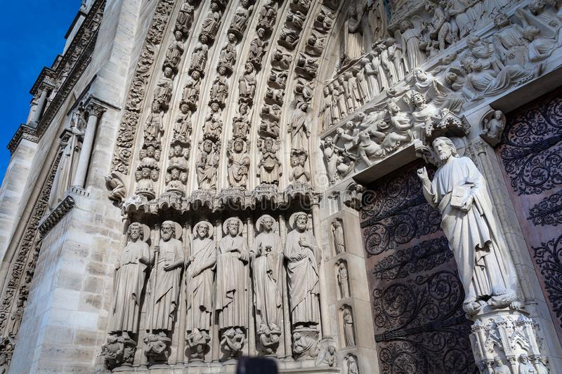 Saints in Tympanum of Last Judgment, central portal on west facade of Notre Dame de Paris royalty free stock image