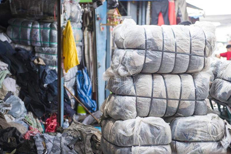 SAKAEO, THAILAND - MAY 21, 2016 : Second hand clothes in plastic royalty free stock images