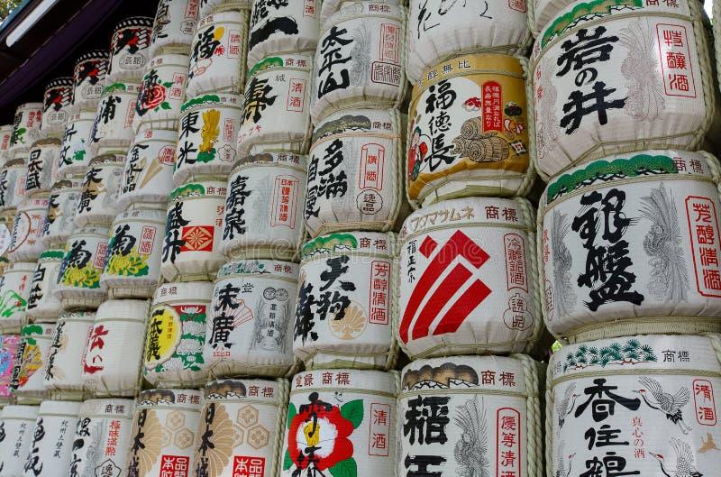 Sake Barrels at Meiji shrine in Tokyo. Sake Barrels full of rice wine with Japanese writing at Meiji-Jingu Shrine, Tokyo, Japan. Photo taken on: April 13, 2013 stock photos