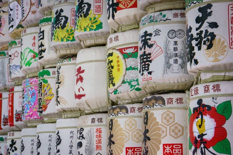 Sake Barrels at Meiji shrine in Tokyo. Sake Barrels full of rice wine with Japanese writing at Meiji-Jingu Shrine, Tokyo, Japan. Photo taken on: April 13, 2013 royalty free stock photos