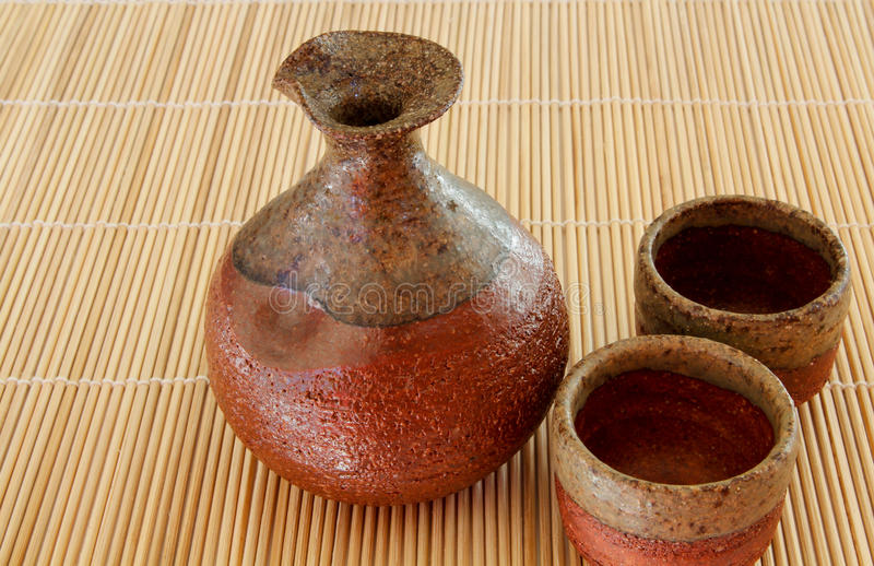 Download Sake Bottle And Two Cups On A Bamboo Mat Stock Photo - Image: 22698488