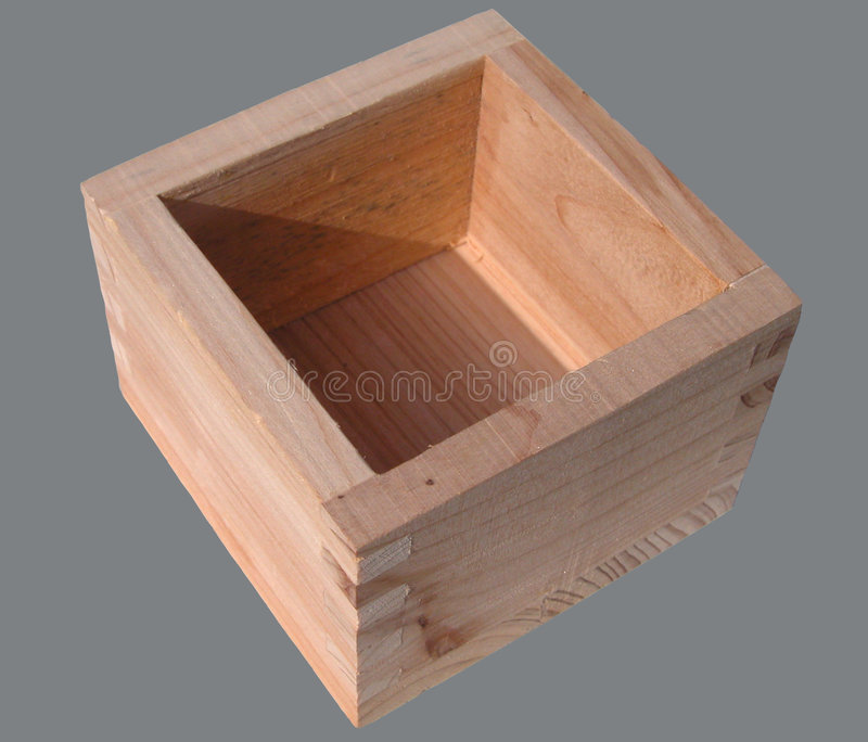 Sake cup. A wooden sake cup-isolation on a grey background royalty free stock photo
