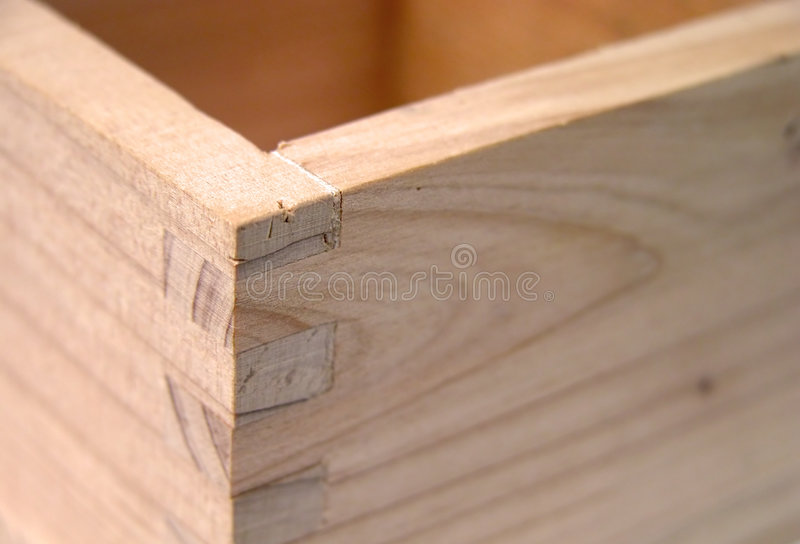 Sake cup detail. Extreme close-up of a wooden Japanese sake cup.Focus on the corner,rest is blurred stock image