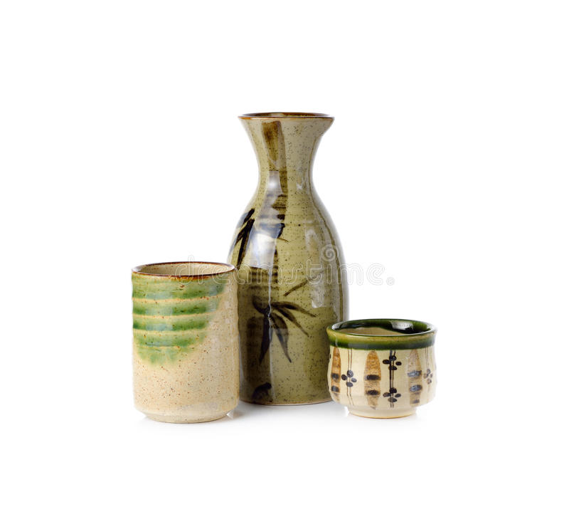 Sake set bottle and cup on white. Background stock images