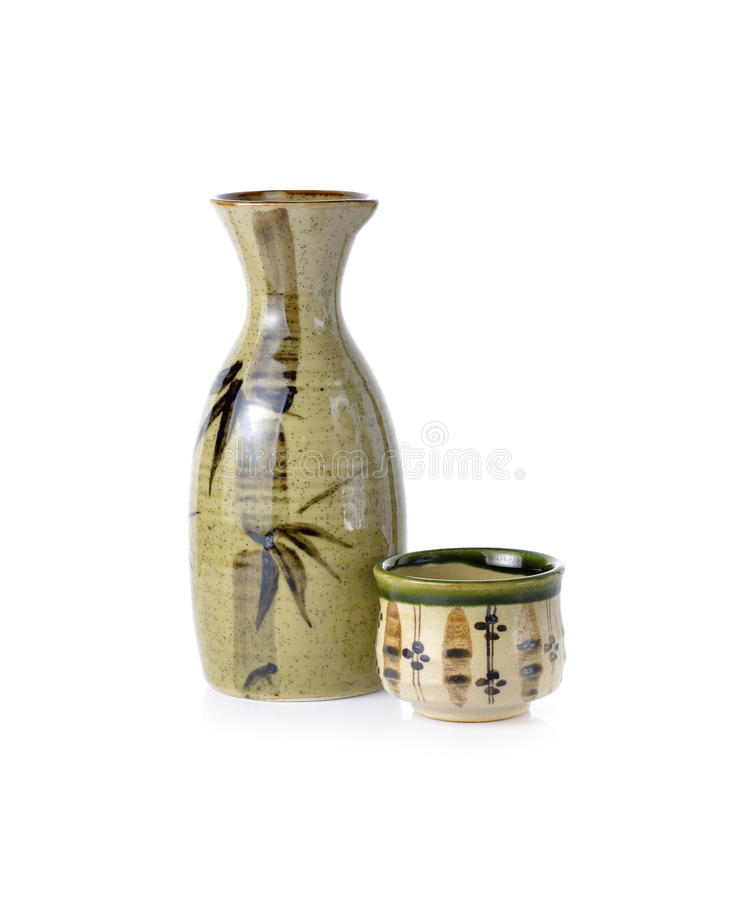 Sake set bottle and cup on white. Background stock photography