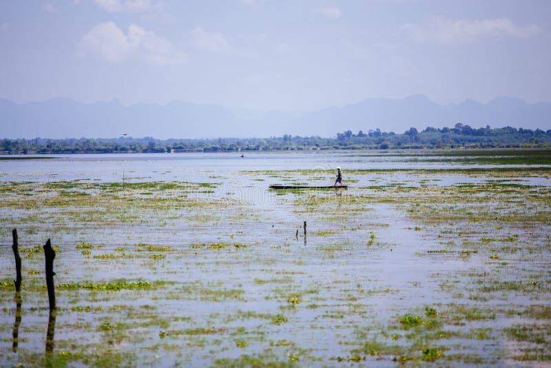 Sakon Nakhon, Thailand - September 16, 2019 : Hard work of fisherman. Morning work on swamp royalty free stock image