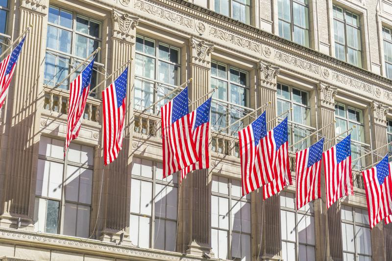 Many flags on the facade of The Saks Fifth Avenue department store in Midtown Manhattan in New York,USA. The Saks Fifth Avenue, American department store royalty free stock photos