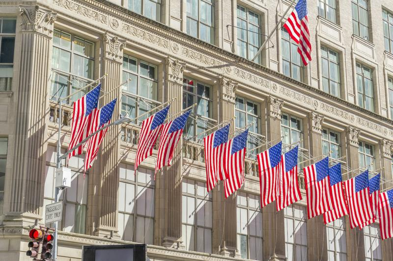 Many flags on the facade of The Saks Fifth Avenue department store in Midtown Manhattan in New York,USA. The Saks Fifth Avenue, American department store stock images