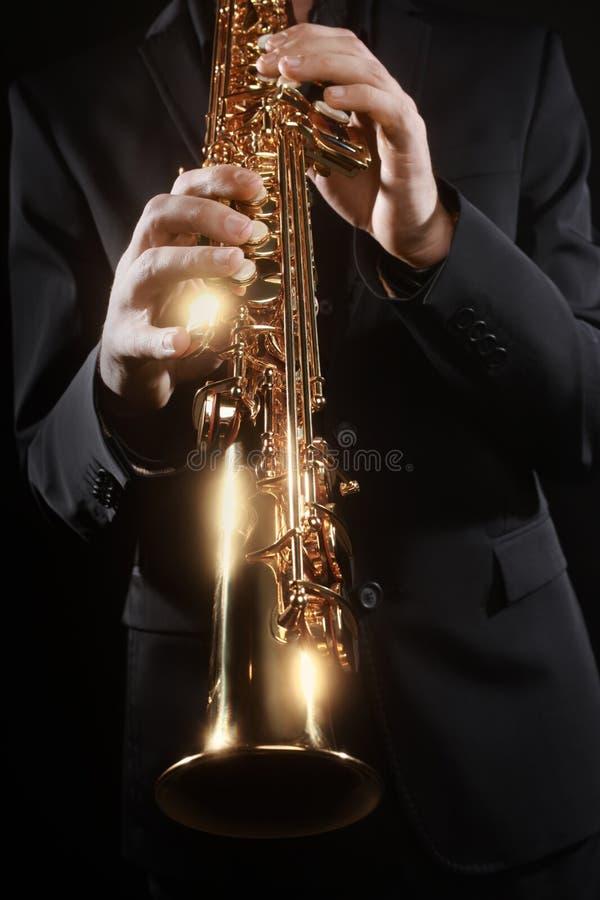 Saksofonowego gracza dyszkanta instrumenty muzyczni zdjęcie stock