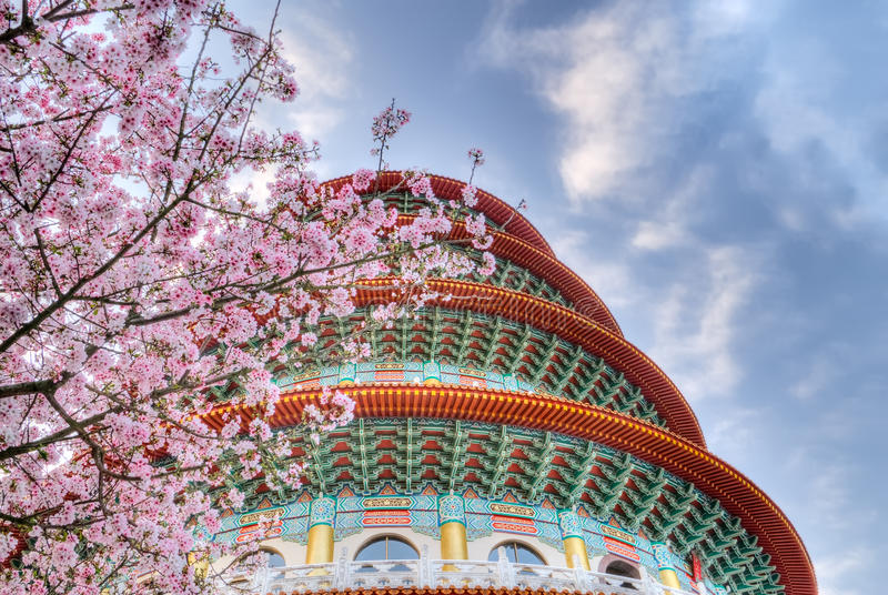 Sakura. Flowers and pagoda on blue sky in day stock image