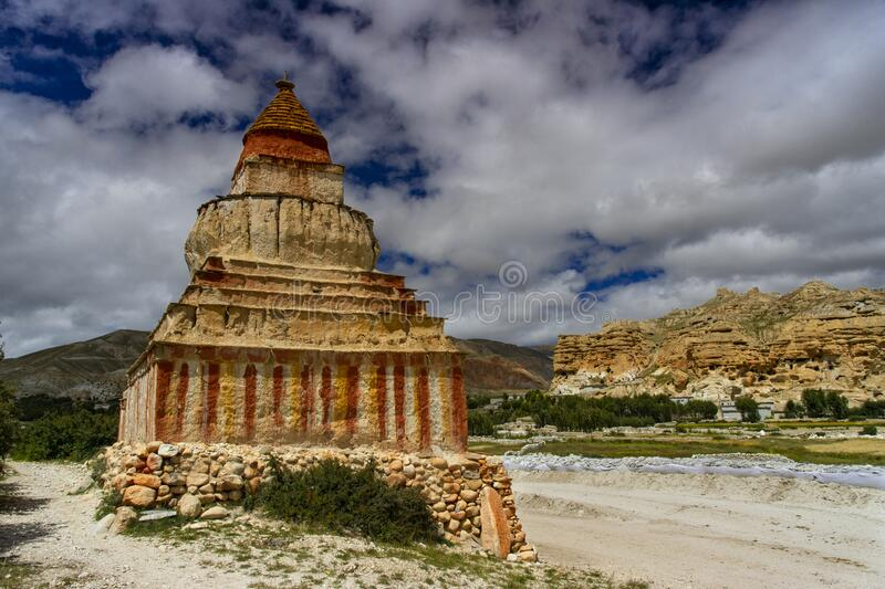 The Sakya stupa and cave dwellings of upper Mustang  , Lo Manthang , Upper Mustang trekking , Nepal. The early history of Lo is shrouded in myth and mystery stock photography