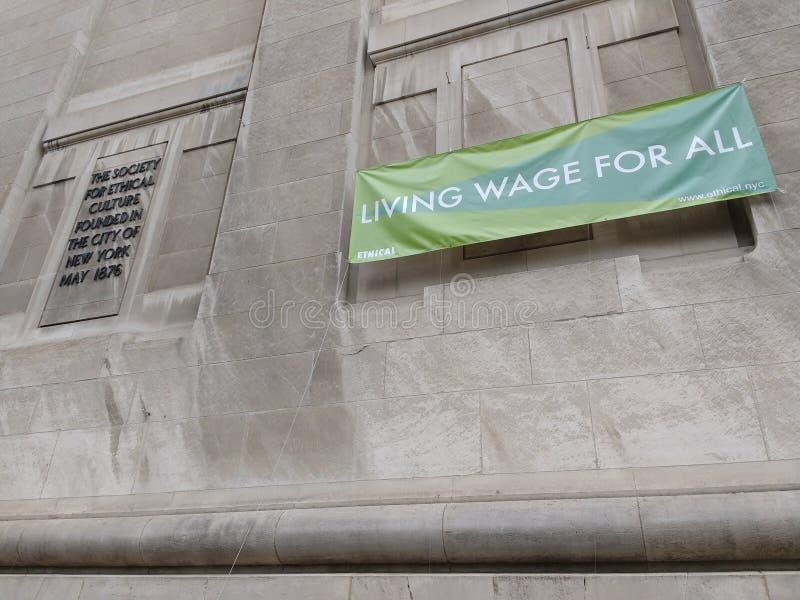 Salário mínimo para tudo, sociedade de New York para a cultura ética, NYC, NY, EUA fotografia de stock