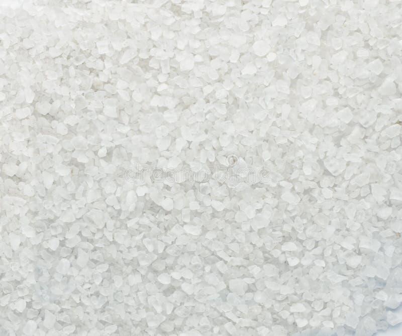 Sal branco do mar dos cristais no fundo macro fotografia de stock