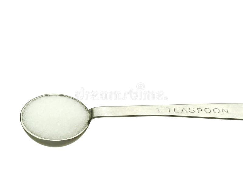 Sal no teaspoon de medição imagem de stock royalty free