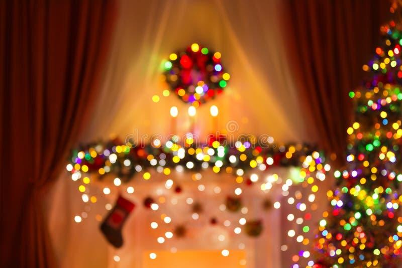 A sala borrada do Natal ilumina o fundo, luz de De Focused Xmas fotografia de stock