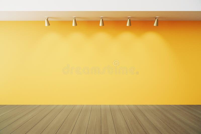Sala vazia com a parede amarela com lapms e o assoalho de madeira fotografia de stock royalty free