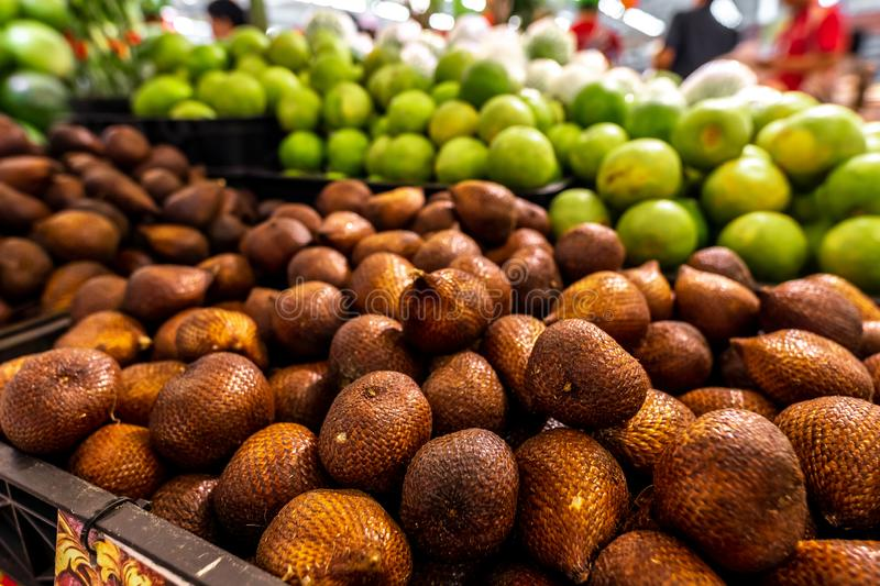 Salacca zalacca or Salak fruits on local market. Fresh and organinc zalacca. Snake fruit is sweet and sour fruit. Snake stock photos