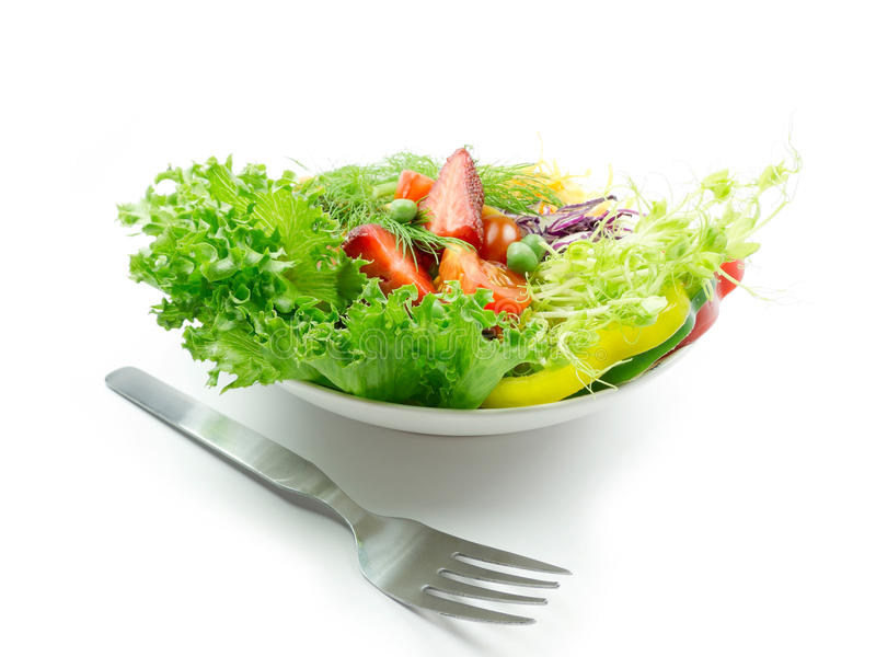 Salad. And fork on white background stock photography