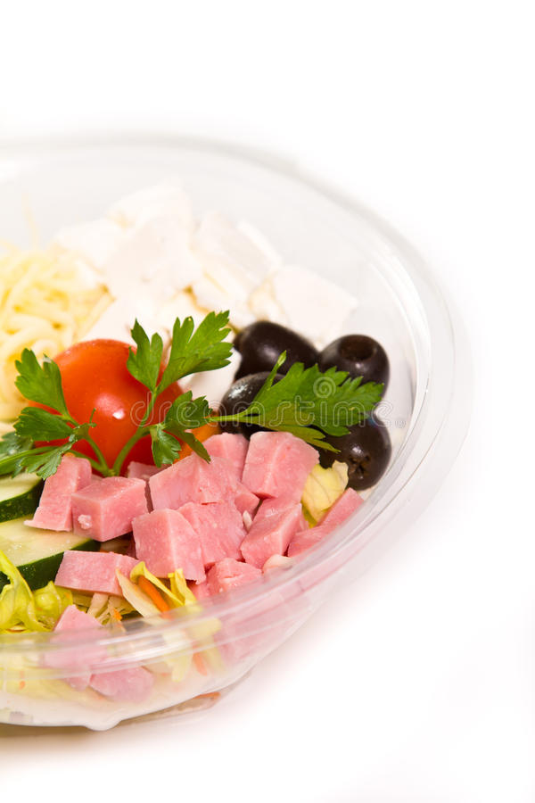 Salad. Catering style salad with veggies, cheese and ham royalty free stock photos