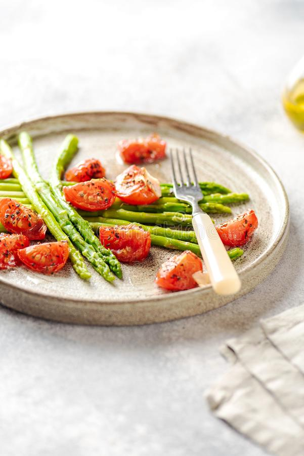 Asparagus with tomatoes royalty free stock photo