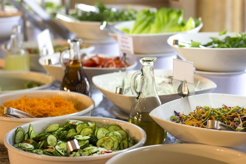 Salad bar in the hotel. Fresh cucumber, carrots and olive oi. Salad bar at the hotel. Fresh cucumber, carrots and olive oi stock image