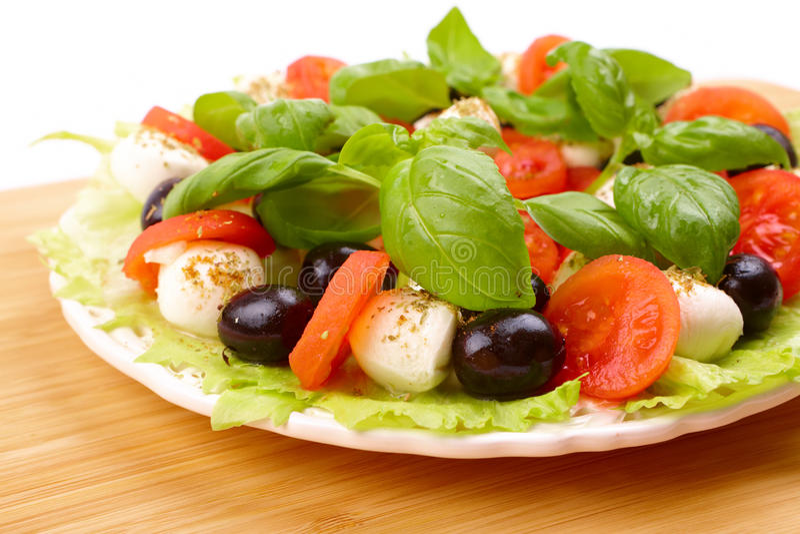 Salad with basil, mozzarella, olives and tomato royalty free stock photos