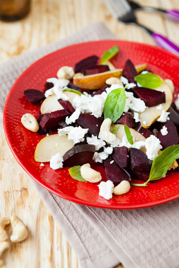 Salad with beets and goat cheese. Close up food stock images