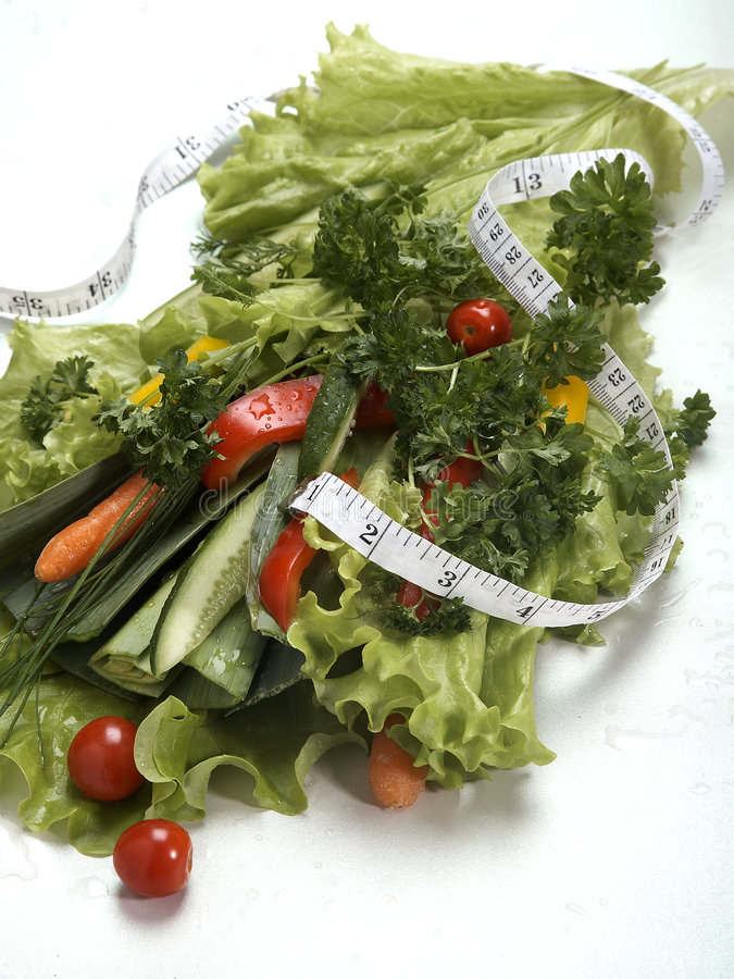 Salad bouquet with measuring tape. On white isolated background stock images