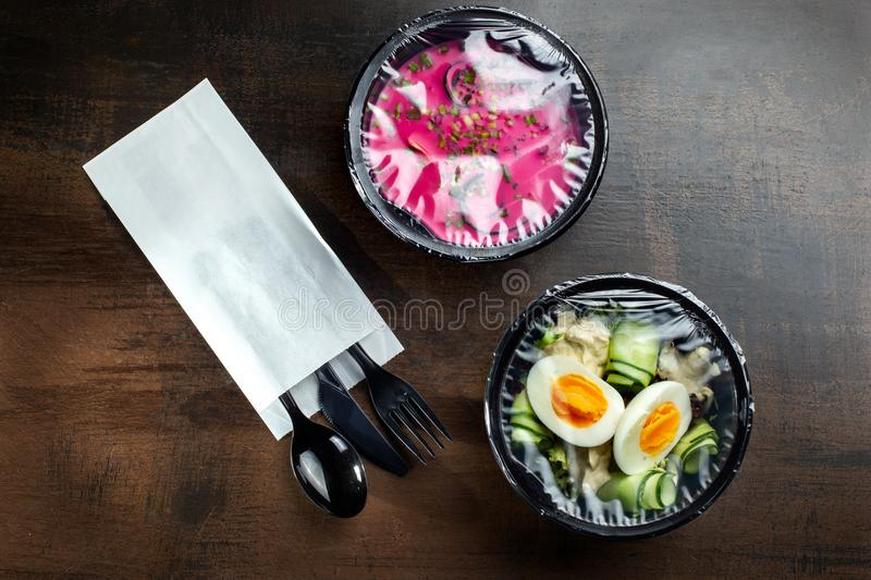 Salad box for delivery with wooden table. Salad.Box. royalty free stock image