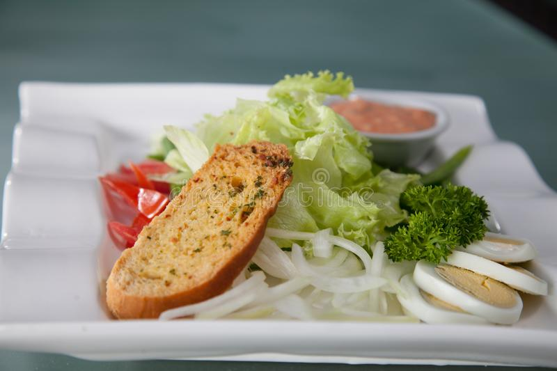 Salad bread on the plate ready to serve royalty free stock photos