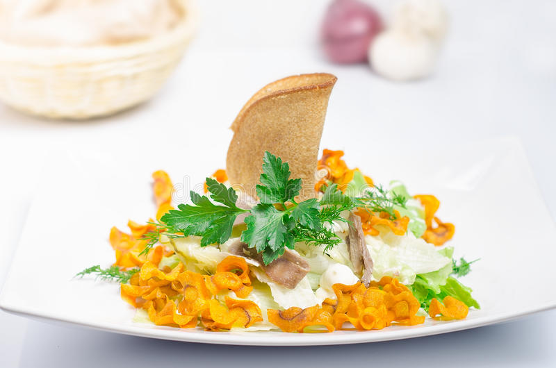 Salad with carrot on a white table royalty free stock photos