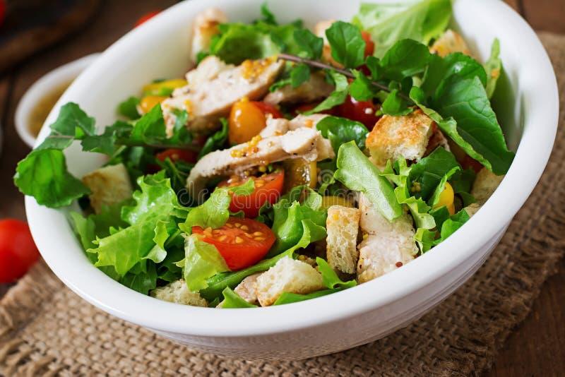 Salad with chicken breast, arugula, lettuce and tomato. stock photo